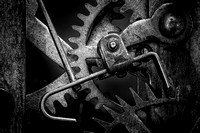 Black and white macro photograph of clockwork gearing