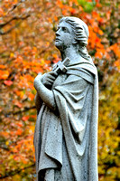 Statue and autumn color at Fern Cliff Cemetery; Springfield, OH